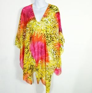 Just be... asymmetrical see through tunic coverup